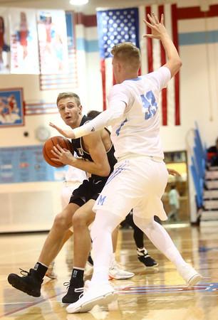 12-29-16<br /> Maconaquah vs Peru boys basketball<br /> Peru's Jonah Lester looks to get around Maconaquah's Wyatt Hughes.<br /> Kelly Lafferty Gerber   Kokomo Tribune