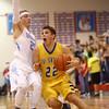 2-26-16<br /> Maconaquah vs Tri Central boys basketball<br /> Tri Central's Colten Leininger looks to score over Maconaquah's Luke Hann.<br /> Kelly Lafferty Gerber | Kokomo Tribune