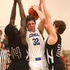 2-23-16<br /> Western vs Carroll boys basketball<br /> Carroll's Spencer Sproul looks for a pass around Western's defense.<br /> Kelly Lafferty Gerber | Kokomo Tribune