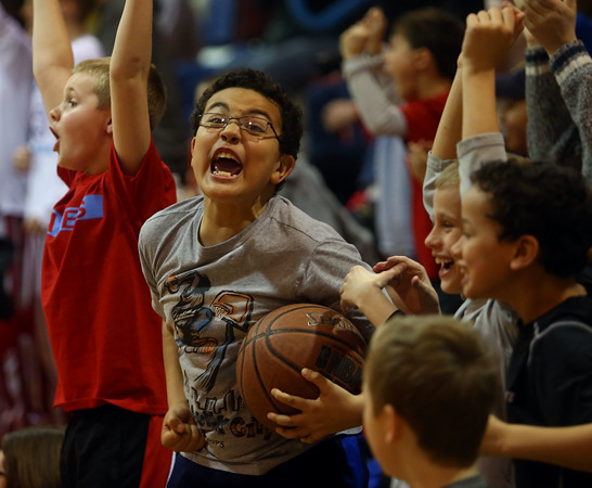 2-26-16<br /> Maconaquah vs Tri Central boys basketball<br /> 10-year-old M.J. Ellis cheers with his friends after Maconaquah's JV team wins by one point at the final buzzer.<br /> Kelly Lafferty Gerber | Kokomo Tribune