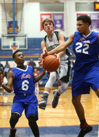 2-17-16<br /> Kokomo blue vs Eastern 8th grade basketball<br /> Kokomo blue's Kohl Beard knocks the ball from Eastern's Matthew Arcari<br /> Kelly Lafferty Gerber   Kokomo Tribune