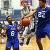2-17-16<br /> Kokomo blue vs Eastern 8th grade basketball<br /> Kokomo blue's Kohl Beard knocks the ball from Eastern's Matthew Arcari<br /> Kelly Lafferty Gerber | Kokomo Tribune