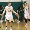 2-9-16 Eastern vs Tipton boys basketball <br /> Eastern's Jacob Kinder (foreground) and Zach Robinson (background) celebrate after Eastern upsets undefeated Tipton.<br /> Kelly Lafferty Gerber | Kokomo Tribune