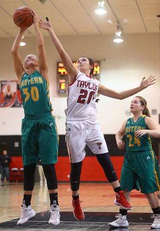 2-2-16 Taylor vs Eastern girls sectional basketball <br /> Eastern's Emily Richards and Taylor's Shaelah Eliason go after a rebound.<br /> Kelly Lafferty Gerber | Kokomo Tribune