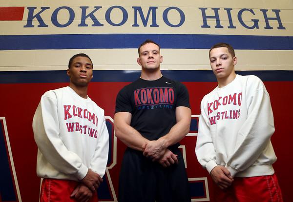 2-18-16<br /> Kokomo's Jabin Wright, coach Ryan Wells, and Szhantrayle Roberson will be heading to state on Saturday.<br /> Kelly Lafferty Gerber   Kokomo Tribune