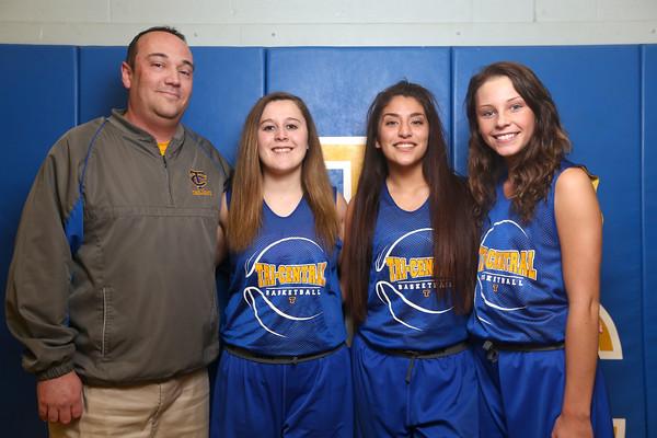 Tri Central's girls basketball coach Kyle Stage with seniors Kelli Kingseed, Serena Quesada, and Haley Farris.<br /> Kelly Lafferty Gerber | Kokomo Tribune