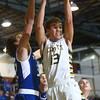 2-9-16 Eastern vs Tipton boys basketball <br /> Eastern's Braden Evans grabs a rebound.<br /> Kelly Lafferty Gerber | Kokomo Tribune