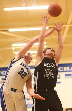 2-23-16<br /> Western vs Carroll boys basketball<br /> Carroll's Spencer Sproul and Western's Brodee Lipinski go after a rebound.<br /> Kelly Lafferty Gerber | Kokomo Tribune