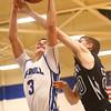 2-23-16<br /> Western vs Carroll boys basketball<br /> Carroll's Jarrett Gish and Western's Corbin Fields go after the rebound.<br /> Kelly Lafferty Gerber | Kokomo Tribune