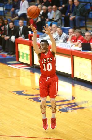 2-19-16<br /> Lafayette Jeff vs Richmond<br /> Cortiz Buckner puts up a three pointer.<br /> Kelly Lafferty Gerber   Kokomo Tribune