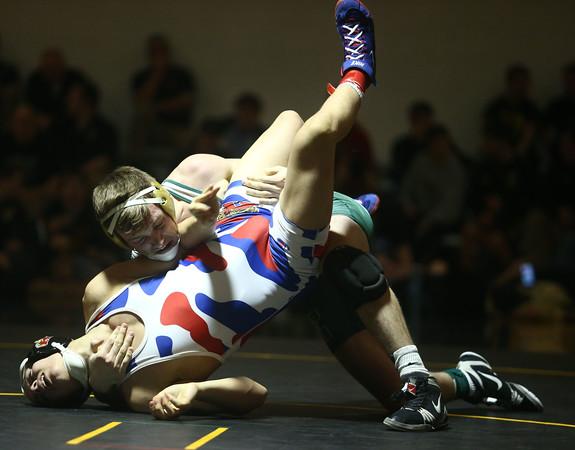 2-6-16<br /> Regional Wrestling<br /> Kokomo's Szhantrayl Roberson and Eastern's Corbin Hetzner in the 145.<br /> Kelly Lafferty Gerber   Kokomo Tribune