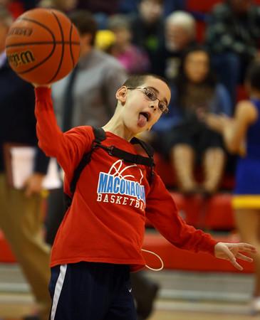 2-26-16<br /> Maconaquah vs Tri Central boys basketball<br /> 8-year-old Hayes Purdy tosses the ball back to Maconaquah during warm ups.<br /> Kelly Lafferty Gerber   Kokomo Tribune