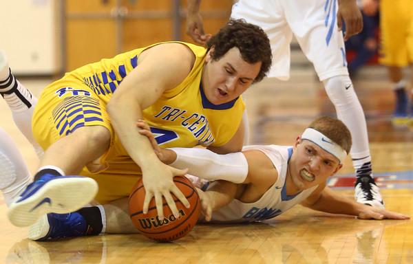2-26-16<br /> Maconaquah vs Tri Central boys basketball<br /> Tri Central's Tanner Fernung and Maconaquah's Luke Hann go after a loose ball.<br /> Kelly Lafferty Gerber | Kokomo Tribune