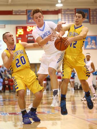 2-26-16<br /> Maconaquah vs Tri Central boys basketball<br /> Tri Central's Dillon Smith and Colby Malson and Maconaquah's Ethan Larason go after a rebound.<br /> Kelly Lafferty Gerber | Kokomo Tribune