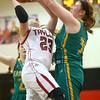 2-2-16 Taylor vs Eastern girls sectional basketball <br /> Taylor's Brie Boehler and Eastern's Hailey Holliday<br /> Kelly Lafferty Gerber | Kokomo Tribune