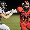 Javon Butler runs around Gap's Carter Rivenburg