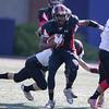 Javon Butler breaks a tackle on a run