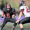 Dorian Hardbarger runs the ball trying to elude a Stonewall Jackson player