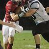 Chandler Breeden pushs past Luray's Spencor Cornelius