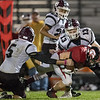 Chandler Breeden fights for extra yardage against Luray's Tristan Yowell and Boo Dean.