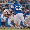 Chris Rogers fights for extra yardage dragging along two Madison County players