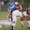 Logan Comer tackles Madison's Isiah Smith during a run.