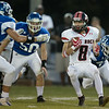 Logan Comer eludes three Madison County players