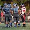 ERHS and SHS players meet for the coin toss.