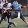 ERHS' Javon Butler runs with the ball as SHS' Joesph Kilimnik attempts to make a takle.