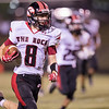 East Rock's Logan Comer runs with the ball.