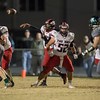 Jaylen McNair passes the ball out to Logan Comer protected by Stone Smith, Logan Dofflemyer, and Prophecy Kisamore