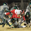 Logan Comer dives through a several Wilson defenders to get some extra yardage.