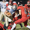 Central's Marshall McAboy is brought down by Haden Morris, and Dorian Hardbarger.