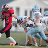 Logan Comer eludes a pack of Panthers
