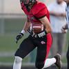 Logan Comer runs the ball