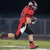 Chandler Breeden runs the ball