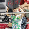 A young ERHS fan holds up a sign from the stands during the third quarter.