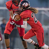 Jaylen McNiar prepares to hand off the ball to Prophecy Kisamore