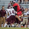 ERHS' Chris Rogers is sandwiched between to Stuarts Draft defenders after making a catch