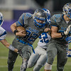 Brayden Dodson with help from Zachary Myers pushes through the Fort defense