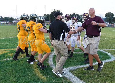 Greenup County head coach Scott Grizzle and Russell head coach TJ Maynard shake hands at midfield before the Backyard Brawl on Saturday evening in Greenup.  MARTY CONLEY/ FOR THE DAILY INDEPENDENT