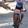 Record-Eagle/James Cook Chloe Woodruff, of Tuscon, Arizona, high-fives fans at the 2016 Iceman Cometh finish line Saturday at Timber Ridge Resort. Woodruff won the pro women's category to claim $6,000.