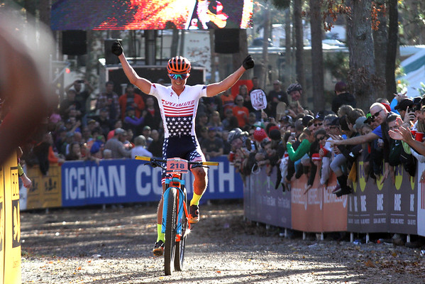 Record-Eagle/James Cook Howard Grotts of Durango, Colorado, celebrates as he nears the Iceman Cometh finish line Saturday. Grotts won the men's pro category to claim $6,0000.