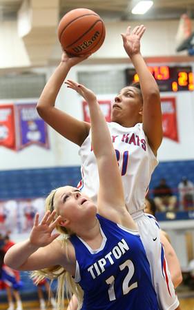1-19-16<br /> Kokomo vs Tipton girls basketball<br /> Kokomo's Allie Lowe shoots over Tipton's Claire Harris<br /> Kelly Lafferty Gerber | Kokomo Tribune