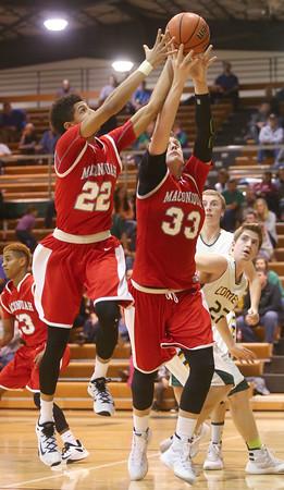 1-8-16<br /> Eastern vs Maconaquah boys basketball<br /> Maconaquah's Brayden Marley and Wyatt Hughes go after a rebound.<br /> Kelly Lafferty Gerber | Kokomo Tribune