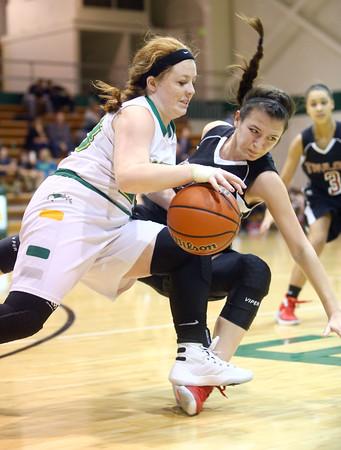 1-9-16<br /> Eastern vs Taylor girls basketball<br /> Eastern's Maci Weeks and Taylor's Shaelah Eliason go after a loose ball.<br /> Kelly Lafferty Gerber   Kokomo Tribune