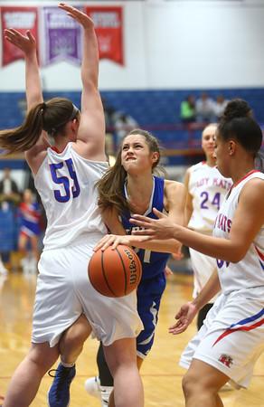 1-19-16<br /> Kokomo vs Tipton girls basketball<br /> Tipton's Cassidy Crawford struggles to get around Kokomo's defense<br /> Kelly Lafferty Gerber | Kokomo Tribune