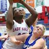 1-19-16<br /> Kokomo vs Tipton girls basketball<br /> Kokomo's Olivia Wilson shoots over Tipton's Claire Harris<br /> Kelly Lafferty Gerber | Kokomo Tribune