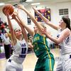 1-5-16<br /> Northwestern vs Eastern girls basketball<br /> Northwestern's Brianna Hahn grabs a rebound, Eastern's Ashlynn Hochstedler and Northwestern's Stephanie Burns<br /> Kelly Lafferty Gerber | Kokomo Tribune