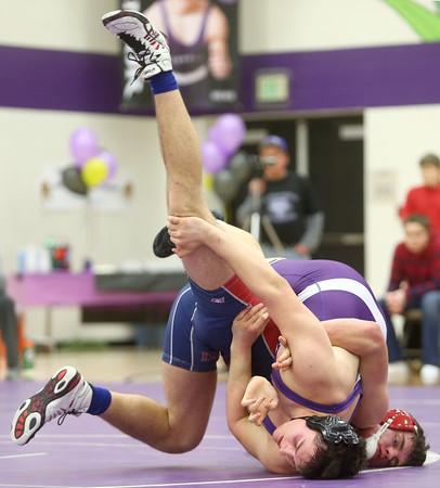 1-21-16<br /> Northwestern vs Cass wrestling<br /> Northwestern's Patrick Harris and Cass' Kirt Ohlemacher in the 195.<br /> Kelly Lafferty Gerber | Kokomo Tribune